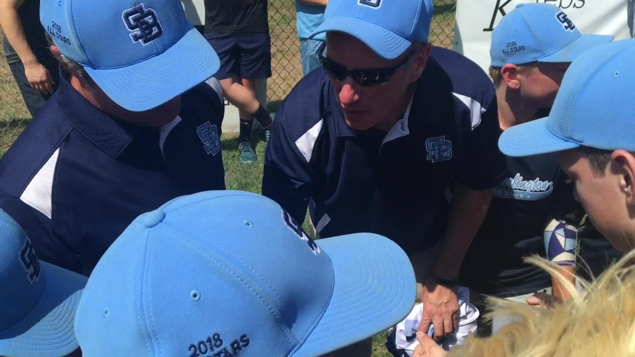 South Burlington huddles around coach Mike Moore after its Little League state championship victory and gets a Gatorade bath.