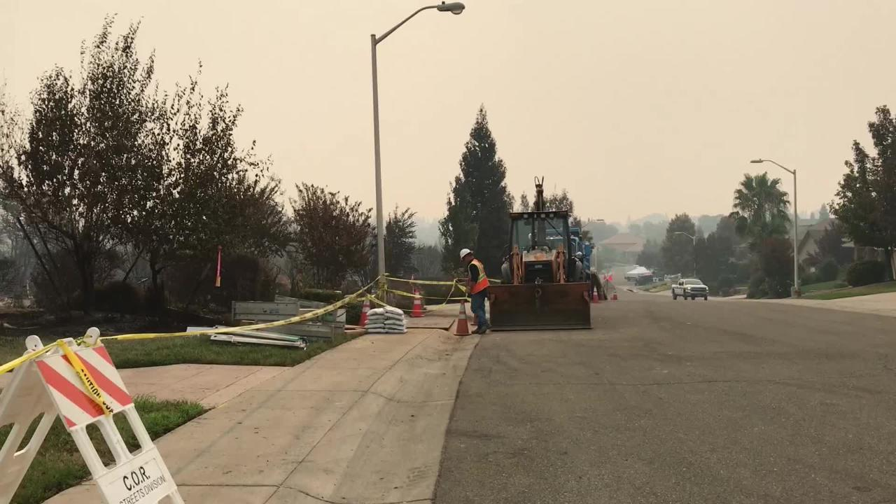 Cal Fire's Cheryl Buliavac was in the Mary Lake subdivision on Wednesday as evacuated residents began to return