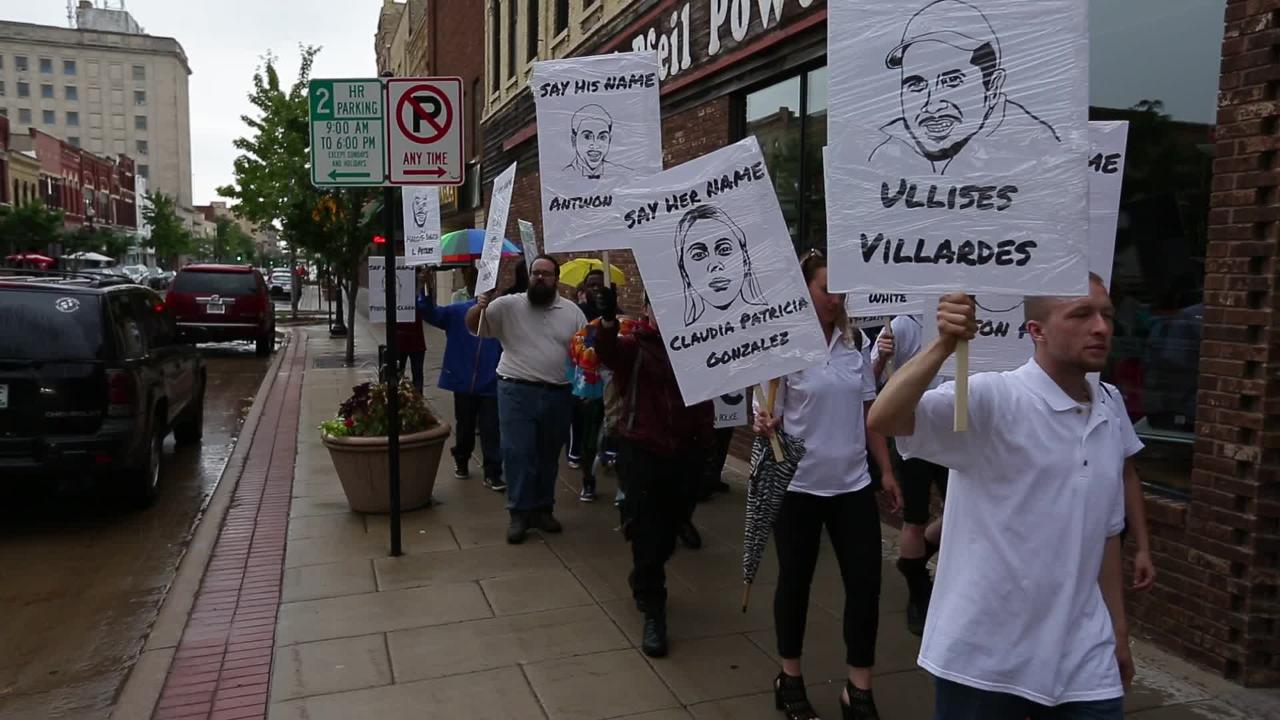 Protestors walk Main Street chanting in protest over police brutality.