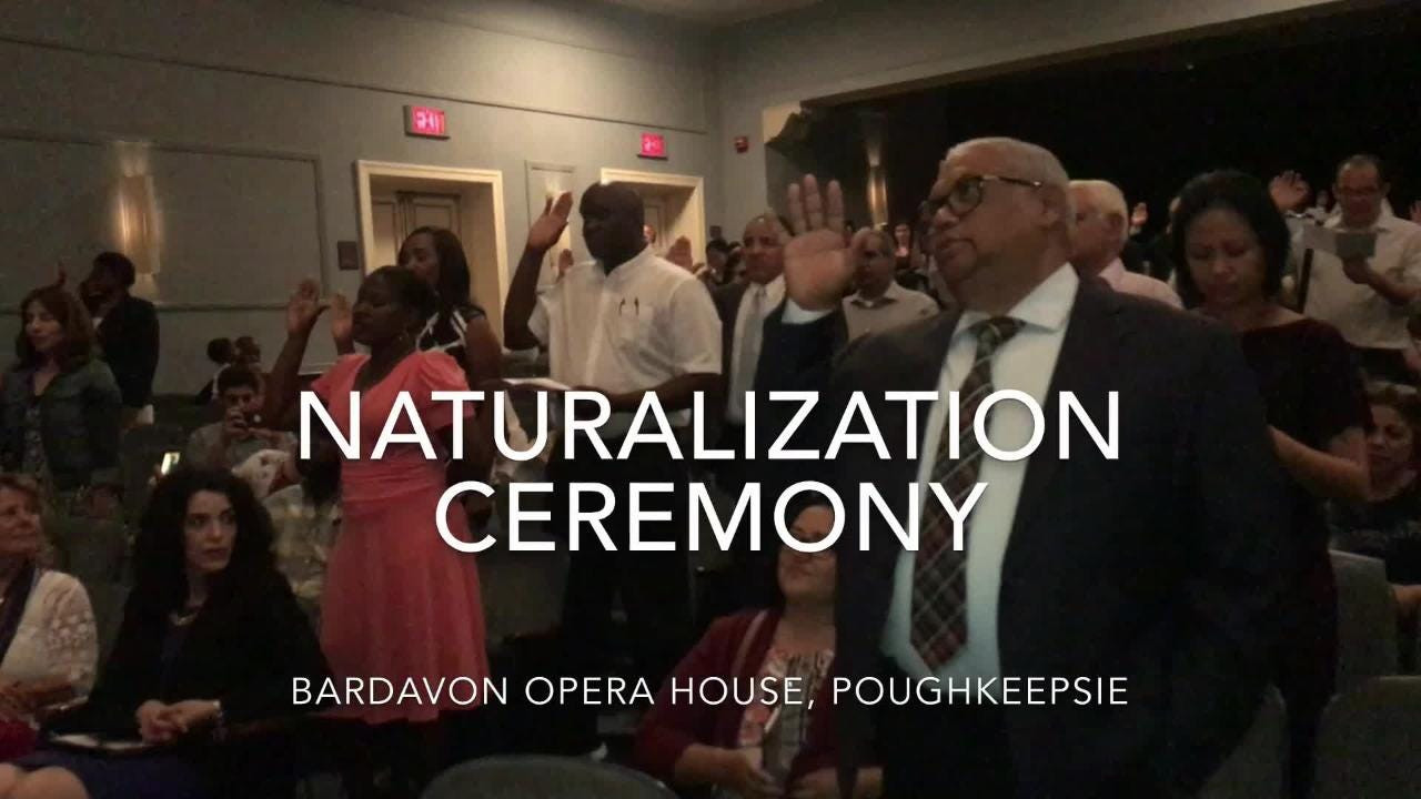 101 people from 41 countries take the oath of allegiance at a naturalization ceremony in Poughkeepsie on Aug. 3, 2018.