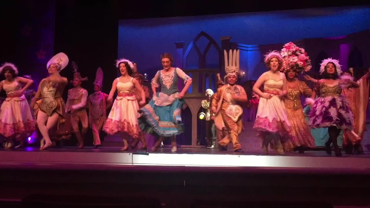 "Belle, portrayed by Laura Fyre of Woodstown, performs ""Be Our Guest"" with the OBSP cast of ""Beauty and the Beast"" at the Levoy Theatre."