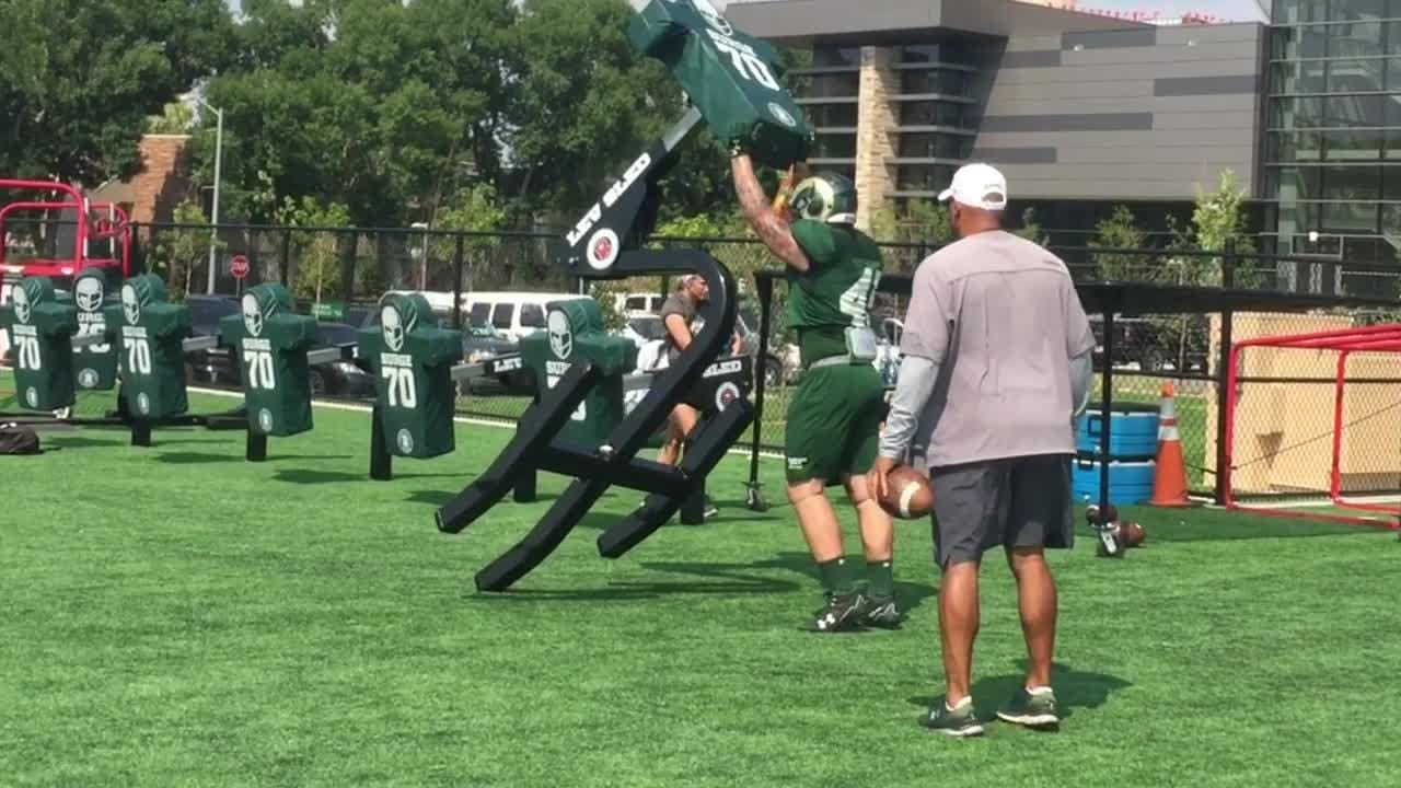 CSU's Adam Prentice, Nate Ryken and Drue Harris (in order) push the sled in practice on Tuesday, Aug. 7.