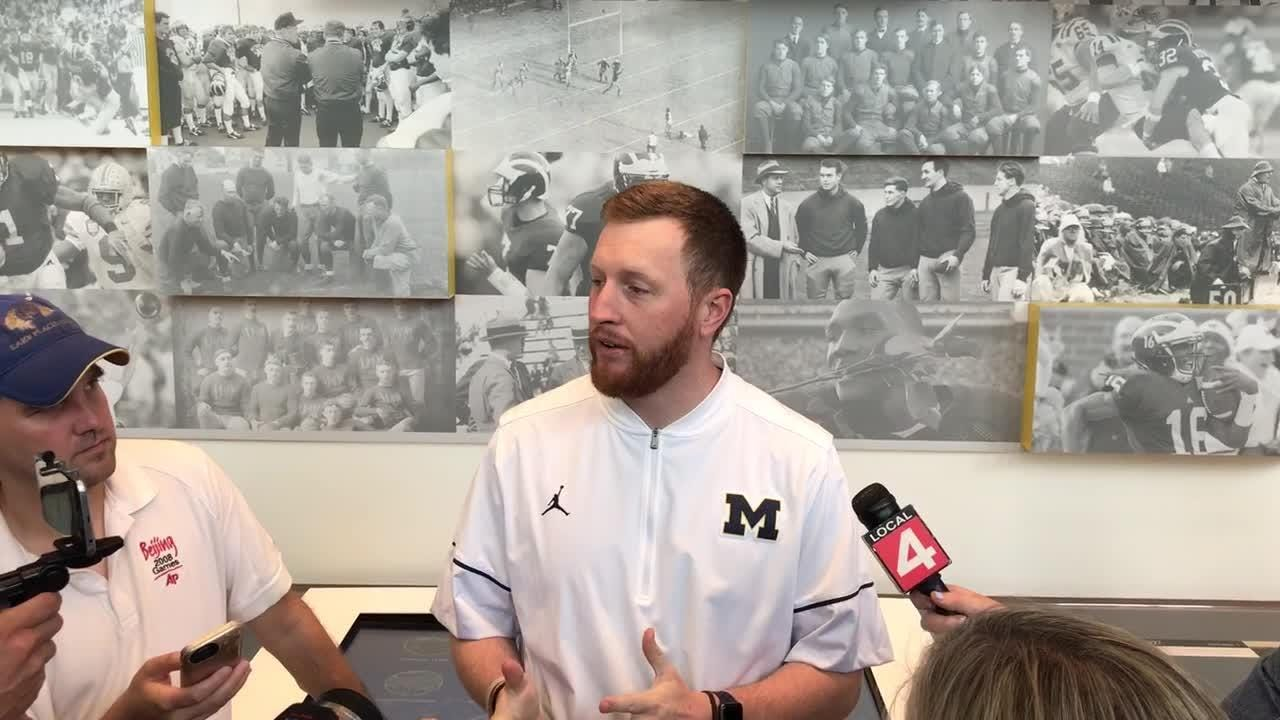 Michigan RB coach Jay Harbaugh meets with reporters in Ann Arbor, Wednesday, Aug. 8, 2018.