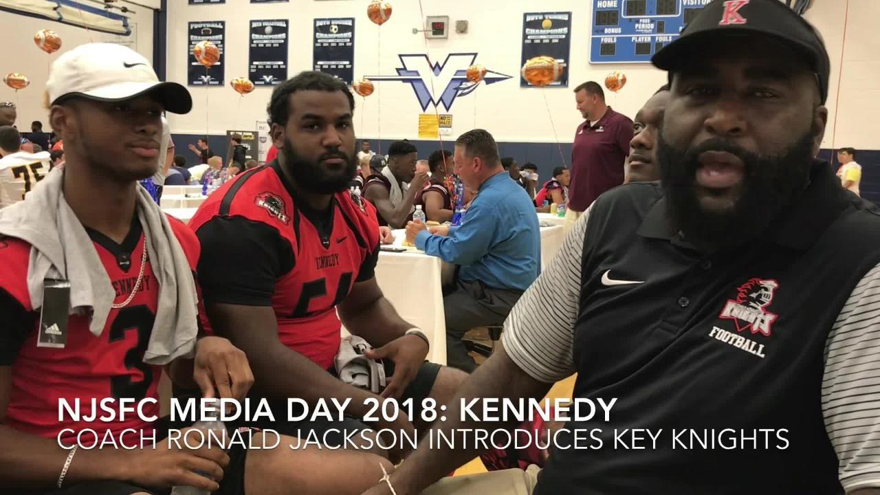 Kennedy football coach Ronald Jackson introduces players Jahmall Readus (22), Jayden Cornish (3), Jaysen Triunfer (54) and Evelon Babbs (1).