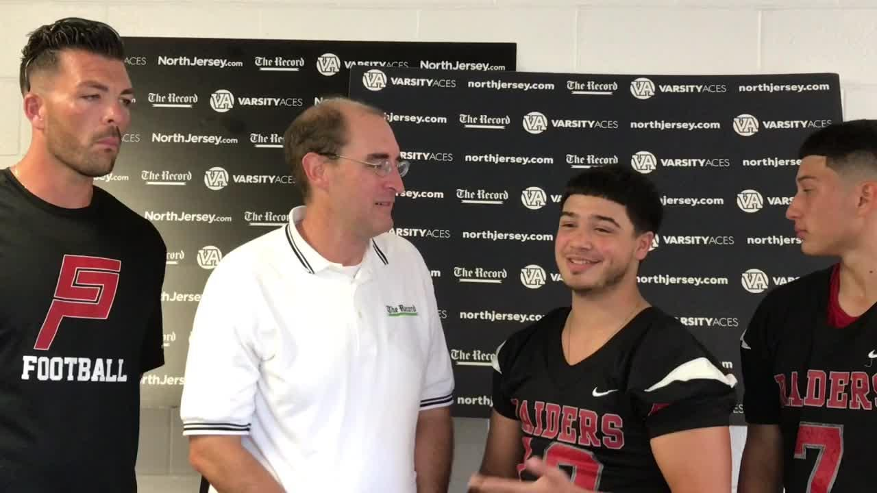 Darren Cooper chats with Cliffside Park football players and coach Tom Mandile at NJSFC Media Day on Thursday, Aug. 9, 2018 at Wayne Valley.