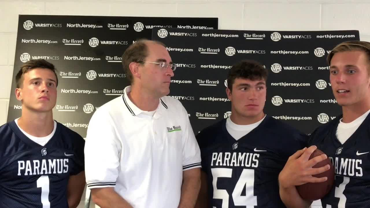 Darren Coopers chats with the Paramus Spartans at NJSFC Media Day on Thursday, Aug. 9, 2018 at Wayne Valley High School.