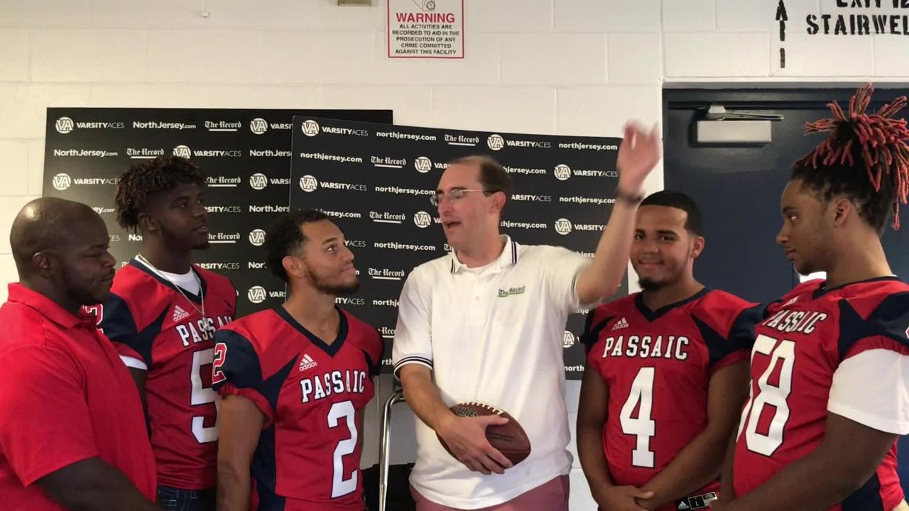 Darren Cooper chats with members of the Passaic Indians football team at NJSFC Media Day on Thursday, Aug. 9, 2018 at Wayne Valley High School.