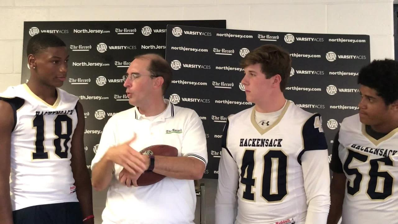 Darren Cooper chats with members of the Hackensack Comets football team at NJSFC Media Day on Thursday, Aug. 9, 2018 at Wayne Valley High School.