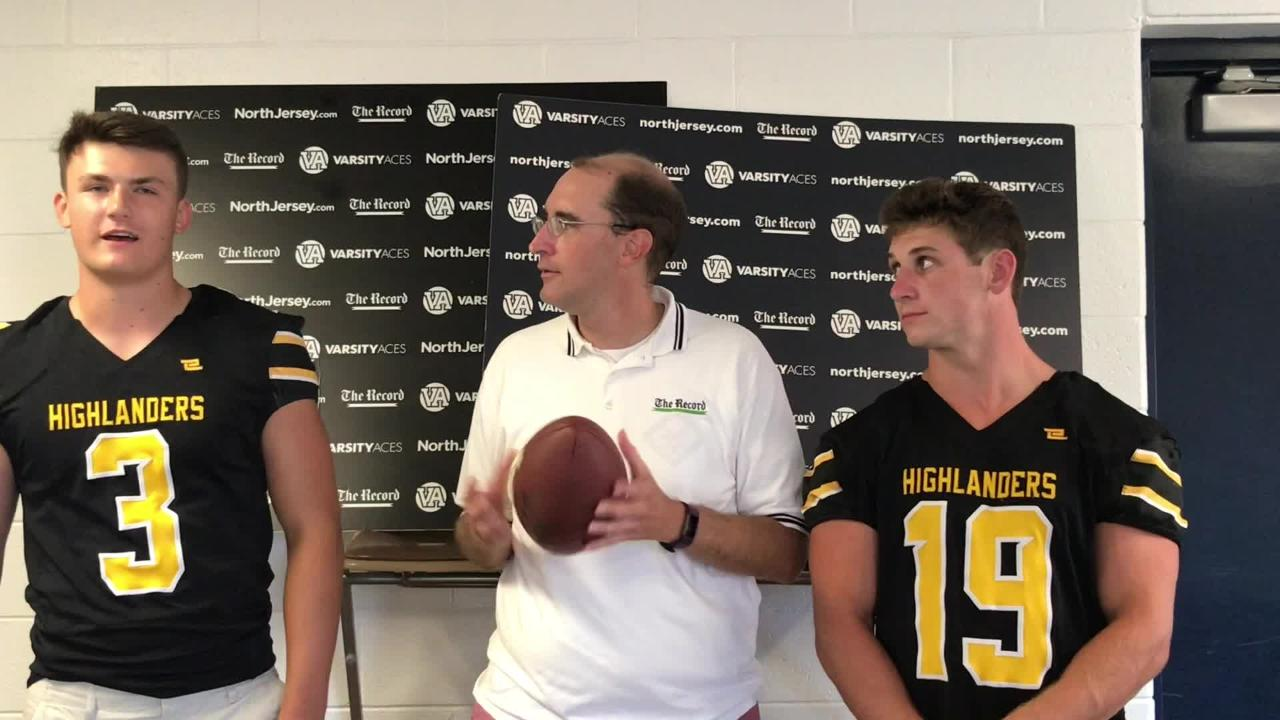 Darren Cooper chats with Zack Milko (3) and Ryan Coyle (19) of the West Milford football team at NJSFC Media Day on Thursday, Aug. 9, 2018 in Wayne.