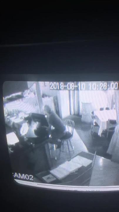 Surveillance video shows someone grabbing cash from the register at Gilardi's Ristorante.