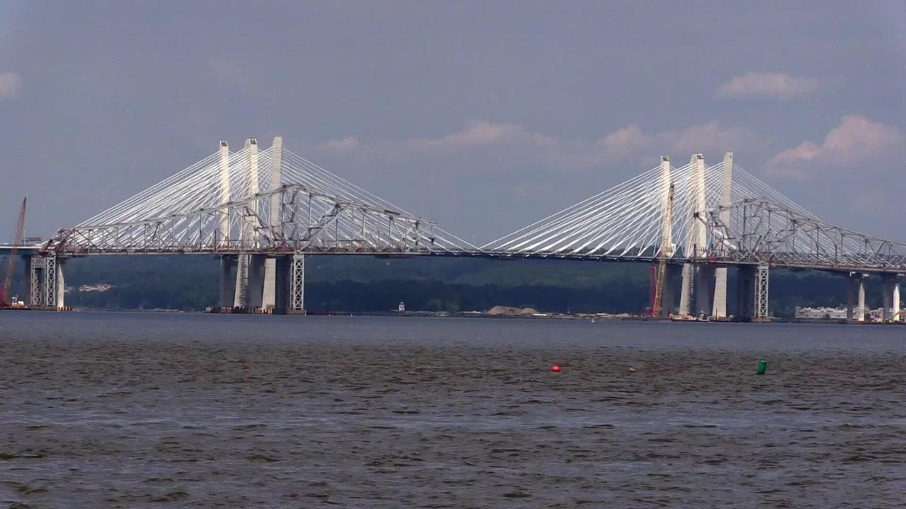 The center span of the Tappan Zee Bridge is taken apart one beam at a time, then the beams are lowered onto a barge.