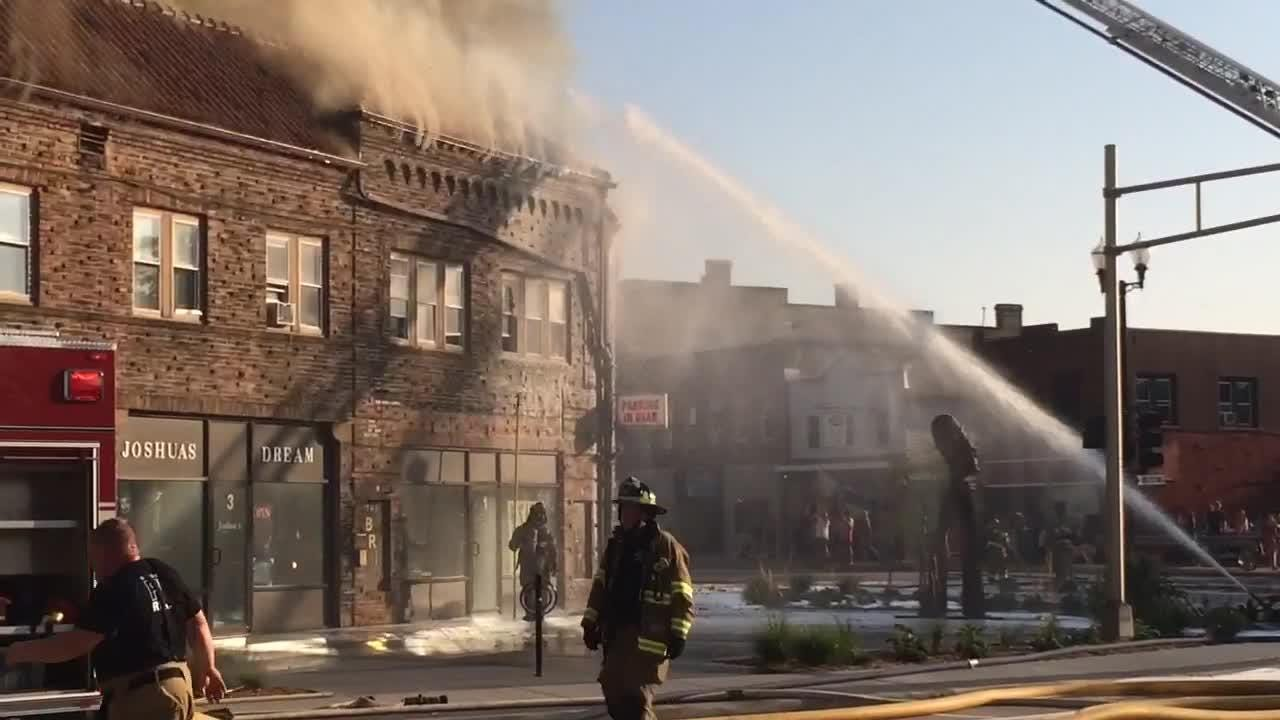 Multiple fire departments responded to fire on Main Street in downtown Menasha on Friday afternoon