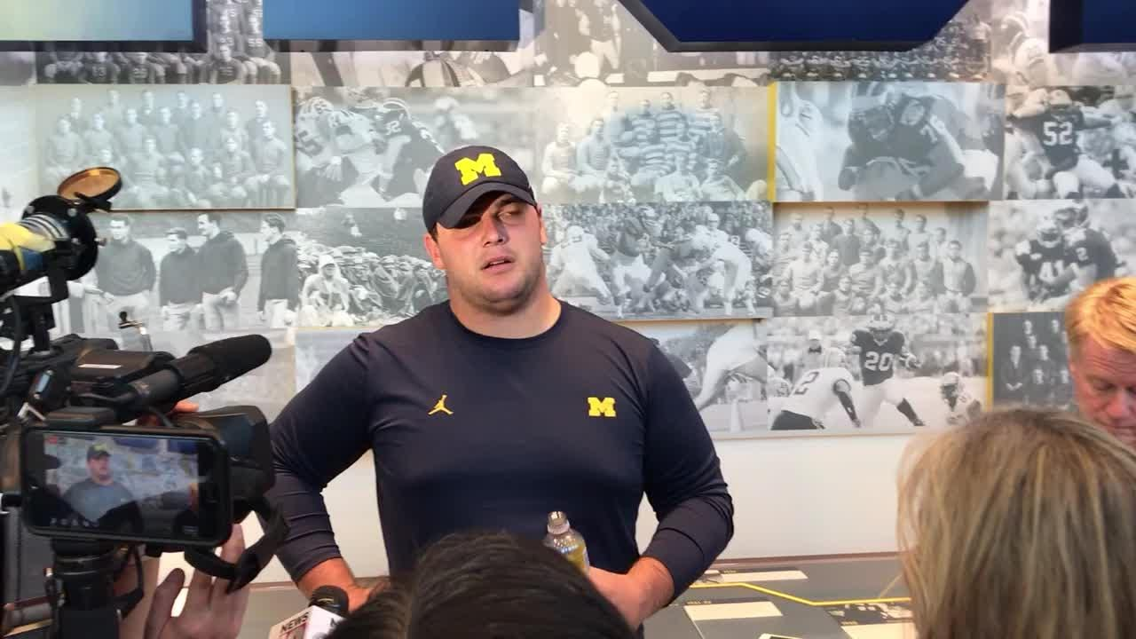 Michigan OL Ben Bredeson speaks with reporters in Ann Arbor on Friday, Aug. 10, 2018.
