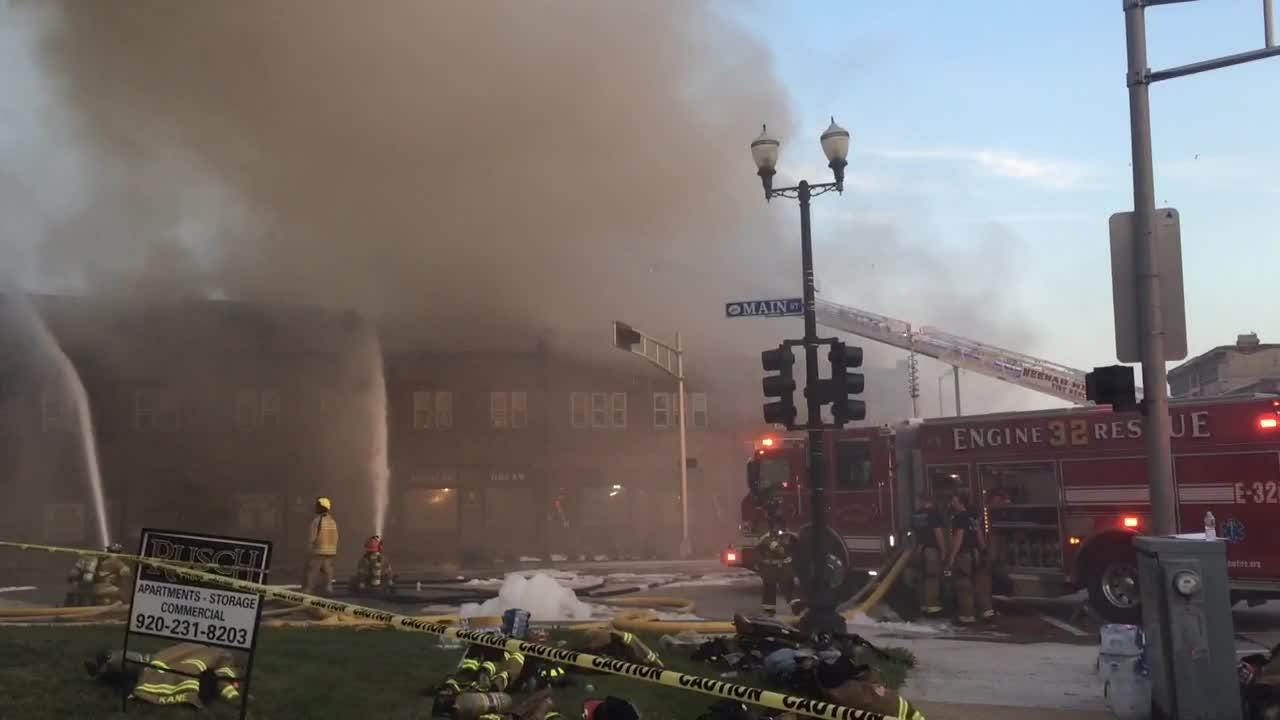 Firefighters continue to try to contain huge downtown Menasha blaze on Friday night.