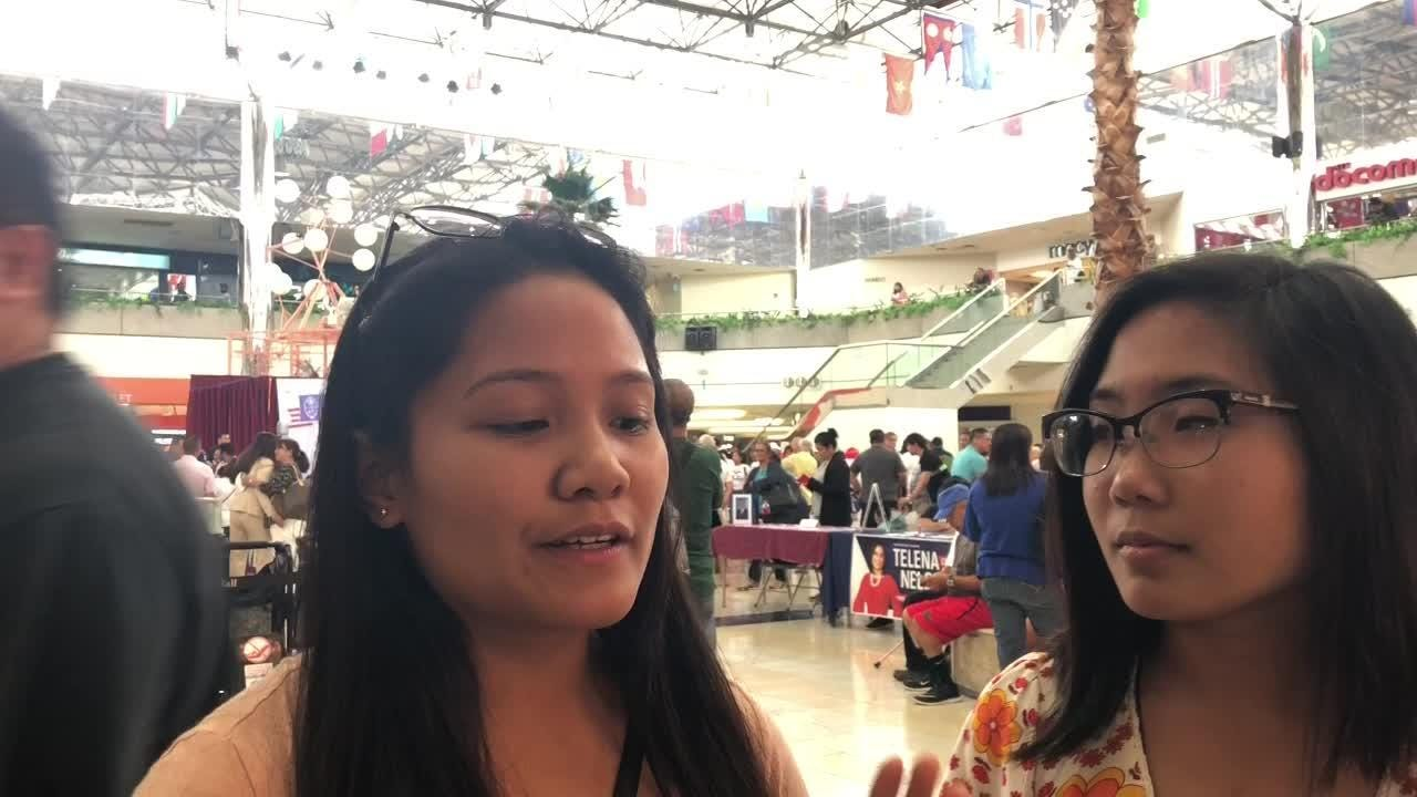 Voters Aria Palaganas, 18, and Harmony Palaganas, 20, stop and talk about what issues are important to them at a candidate event on  Aug. 11, 2018.