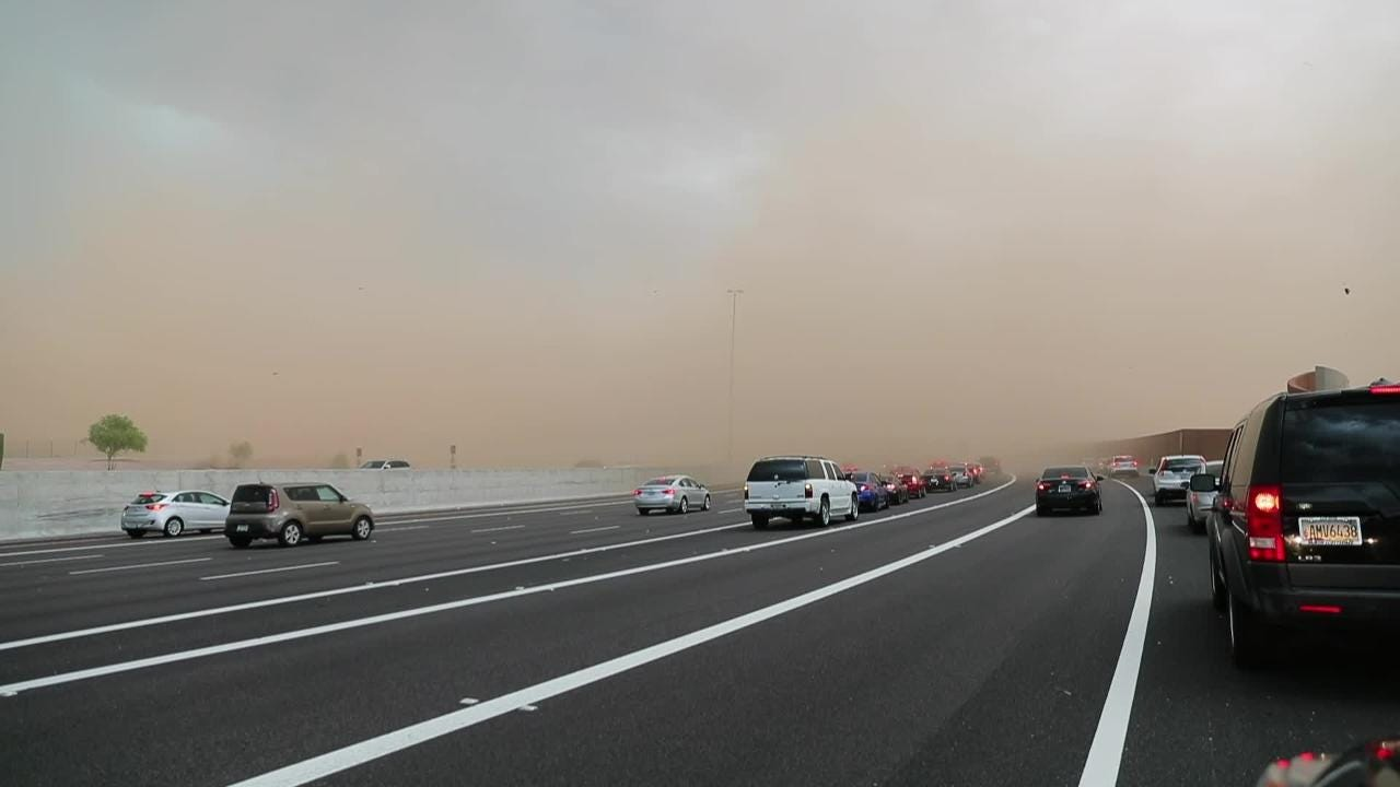Dust storm halts southbound traffic on Loop 101 near E. Via Linda Sunday.