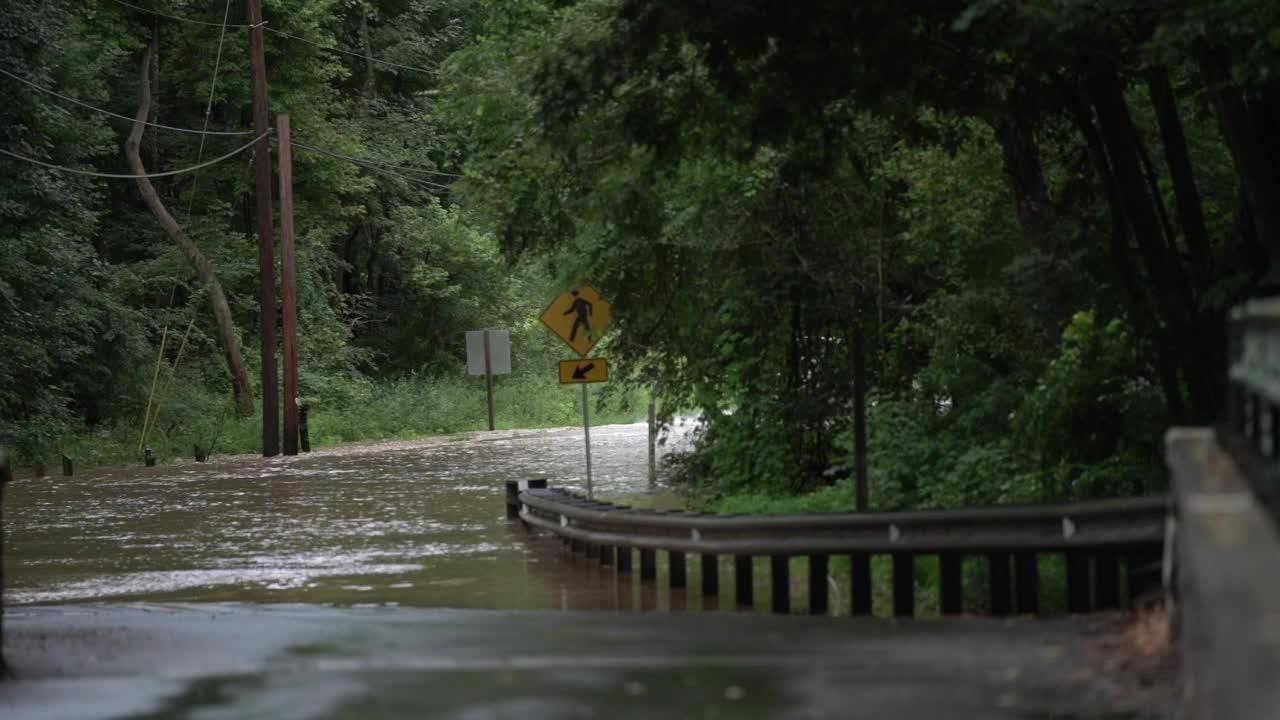 A truck drives through flooded Chambers Rock Rd. Newark