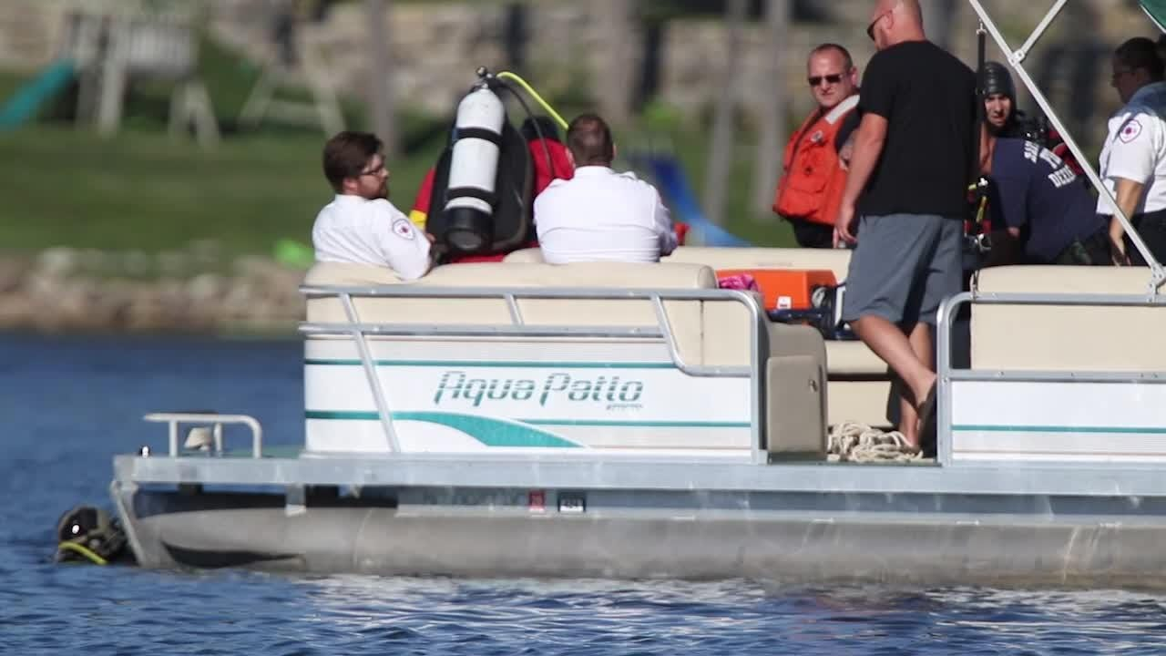 Divers search Lake Shannon in Tyrone Township for a woman who didn't return to the surface Aug. 10.