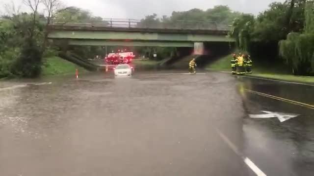 Crews responded to a car stuck in high water near 99 Garnsey Road in Pittsford.