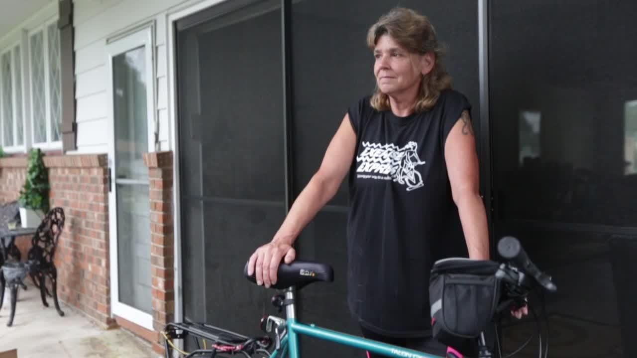 Kim King rides 400 miles from Buffalo to Albany for recovery services.