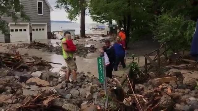 Jeremy Porter of Interlaken says his family escaped  toward Seneca Lake as water rushed through the house.