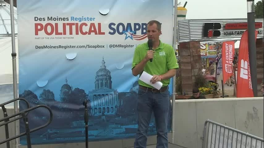 Republican Mike Naig speaks at the Political Soapbox