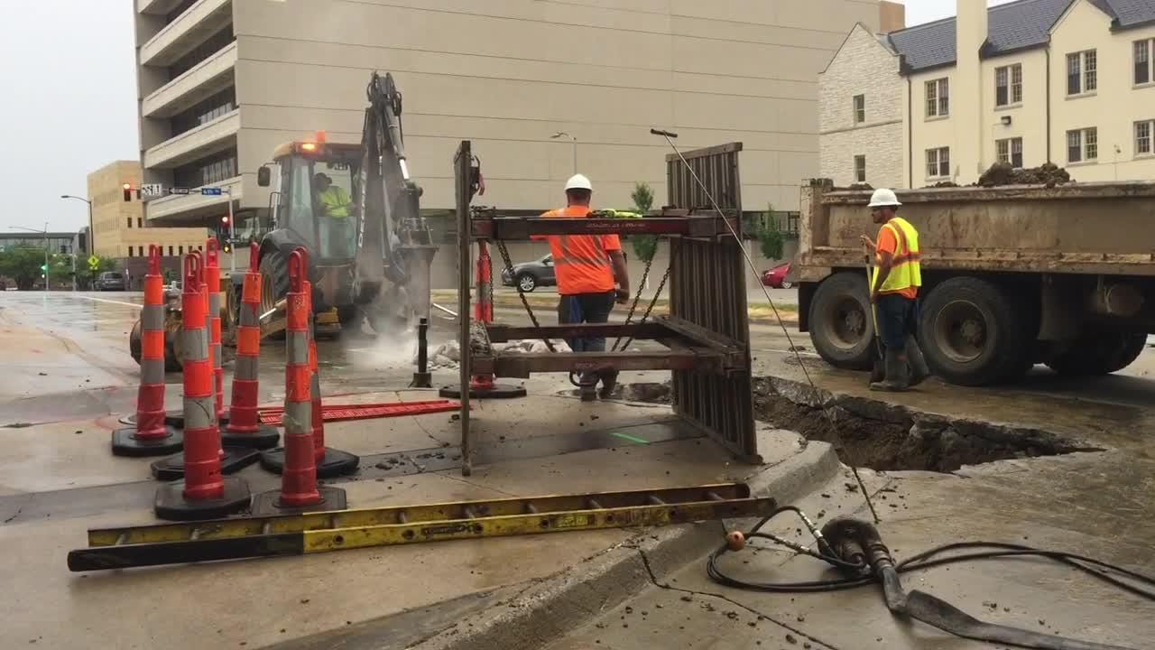 Des Moines Water Works crews hammer out a portion of Park Street in downtown Des Moines.