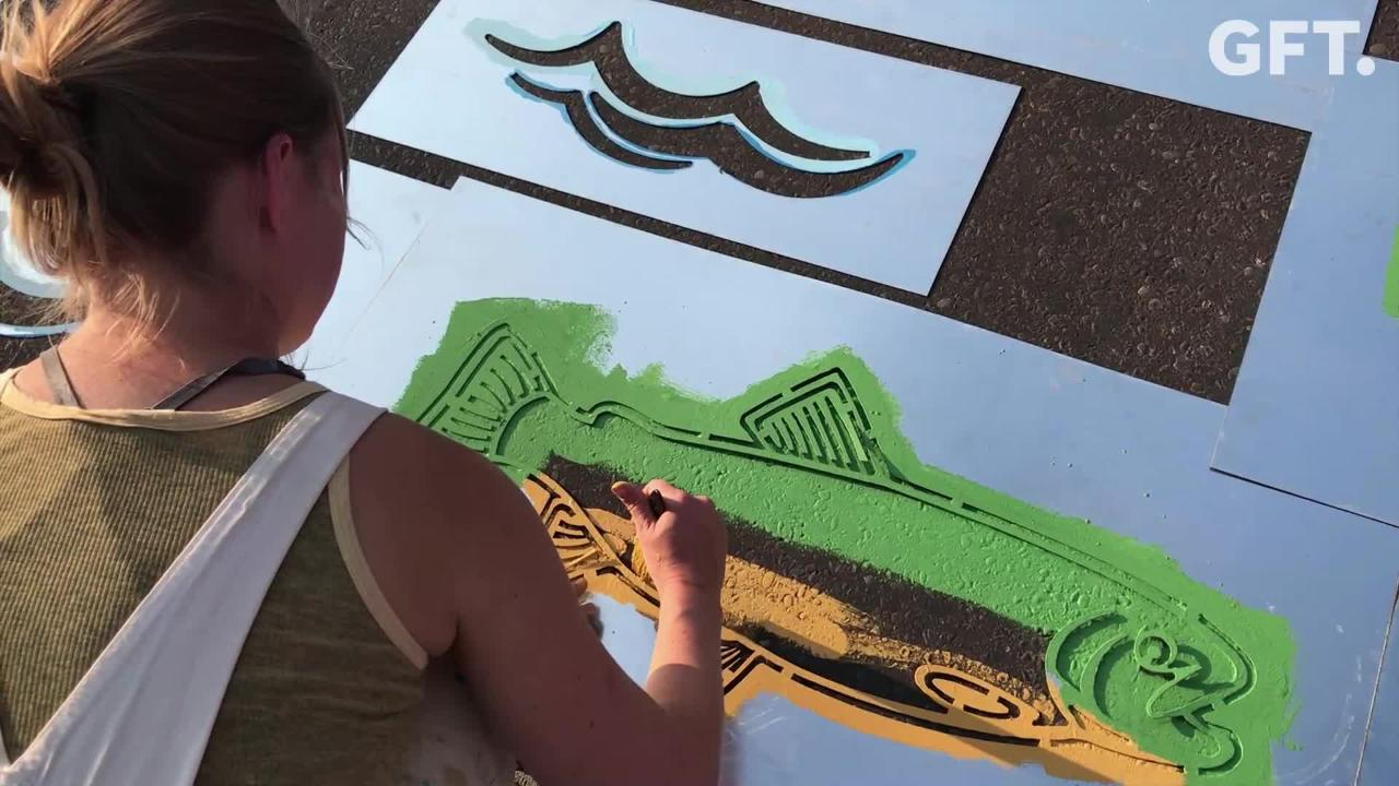 Get Fit Great Falls, in partnership with several local businesses, is beautifying downtown crosswalks with hand-painted trout and waves.