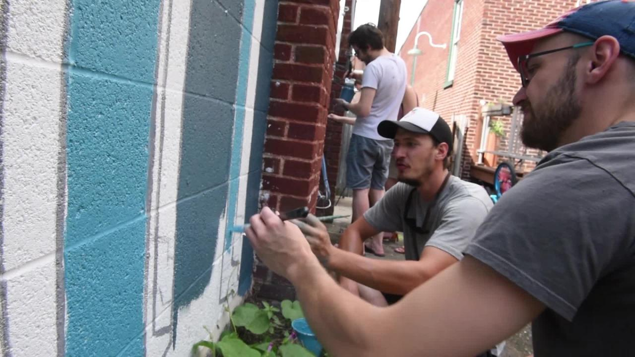 """To foster community, a Gettysburg art group created a paint-by-number mural of a """"brain forest."""""""