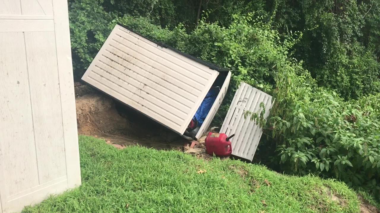 Brick landslide claims couple's backyard