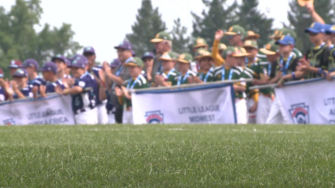 Players with the Grandview Little League  team from Des Moines march in a parade kicking off the 2018 Little League World Series.