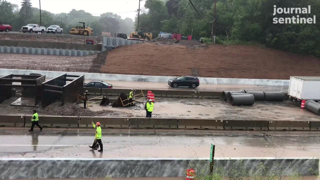Emergency crews rescued a man from a car on a flooded I-43