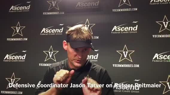 Defensive coordinator Jason Tarver demonstrates where former Lipscomb standout Rutger Reitmaier is improving on the defensive line.