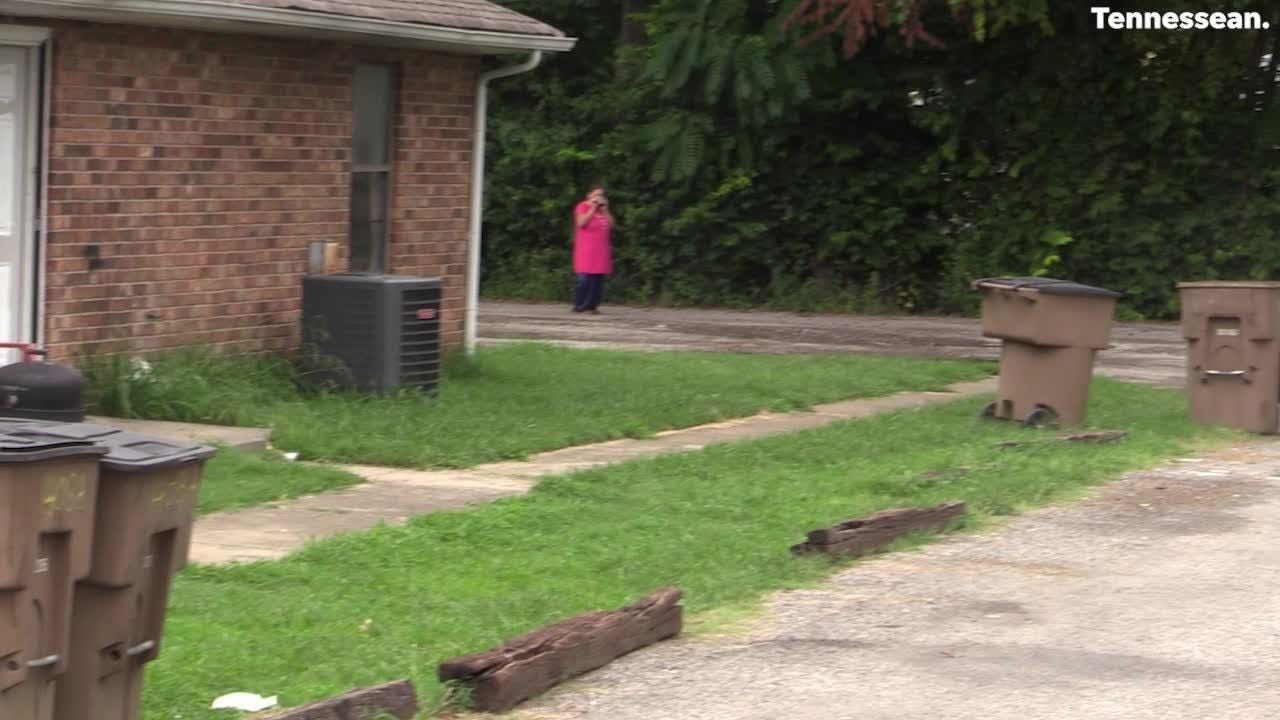 Police show the location of the dropped belongings of the East Nashville shooting victims