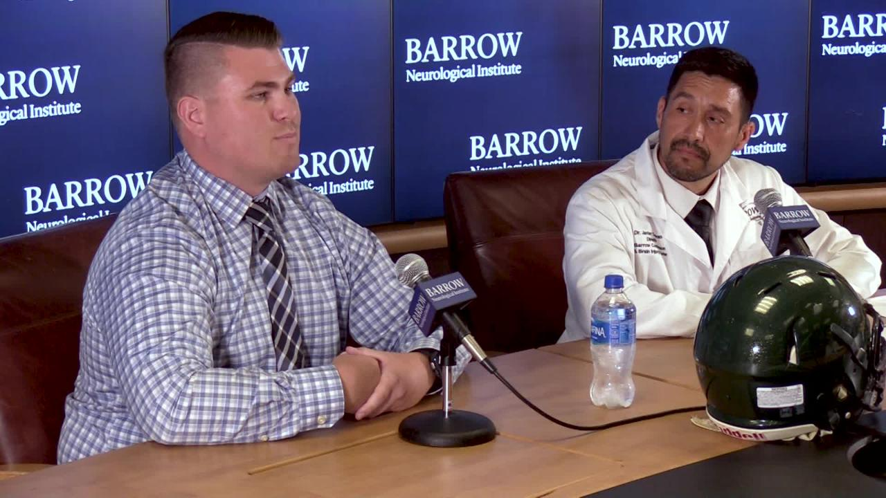 Former Basha High defensive lineman Wyatt Ellis (left) shares the story of his concussion with Dr. Javier Cardenas at Barrow Neurological Institute.