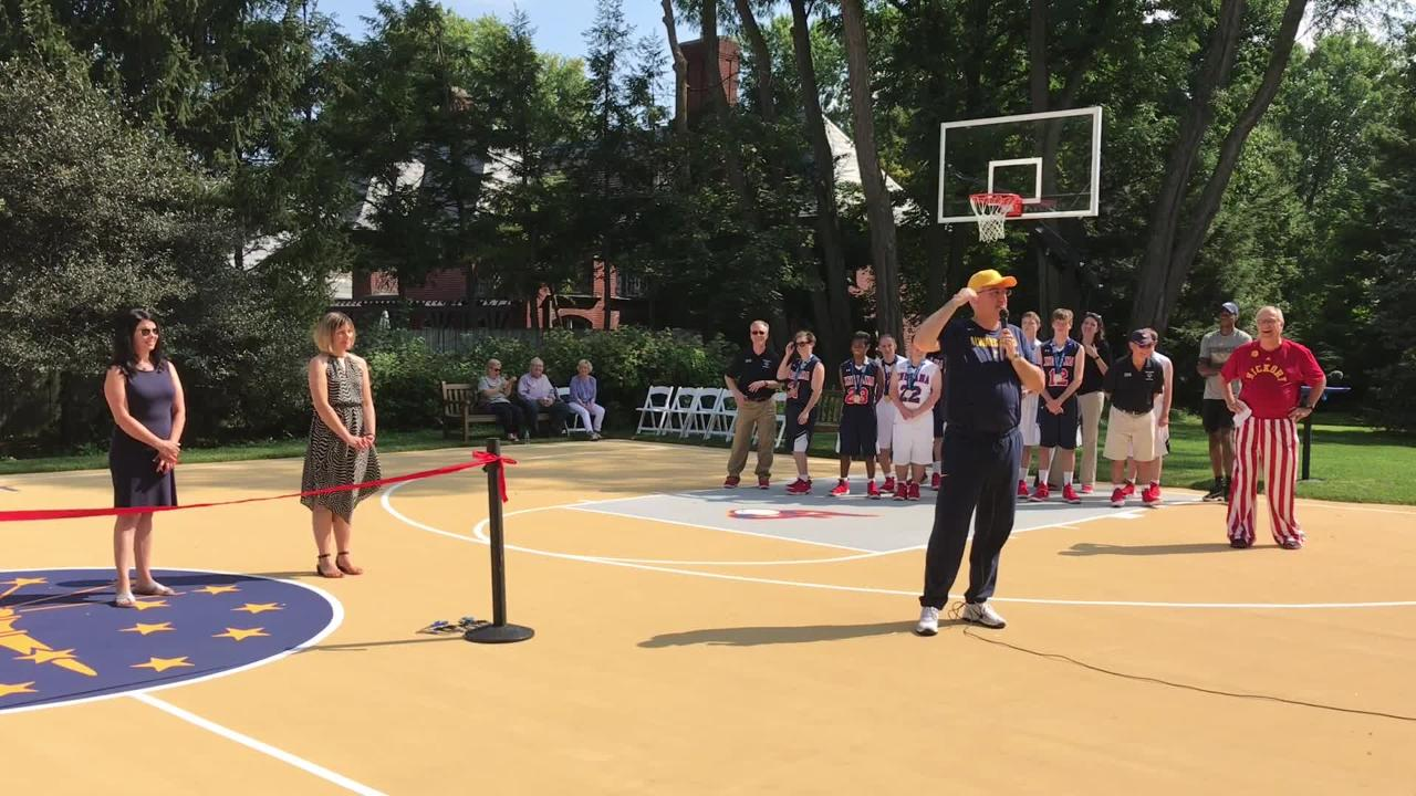 Gov. Eric Holcomb talks about the idea for the basketball court and why it's a family joke that it's positioned right next to the garden.
