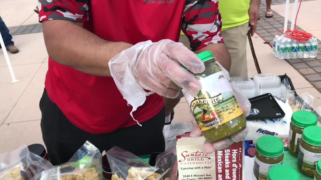 Chris Martinez, Santa Fe Grill supervisor, talks about the Wildfire salsa during the 2018 Las Cruces Summer Beer Festival and Salsa Fest at Plaza de Las Cruces on Saturday, August 18, 2018.