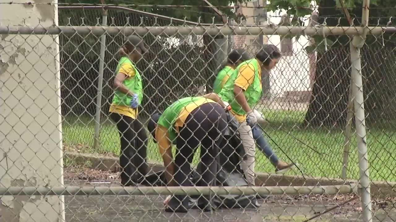 Students spent part of their weekend cleaning up the Adams Street basketball court and surrounding areas.  8/20/18