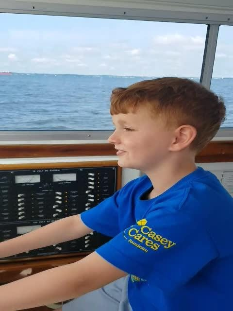 Liam Young , 7, of Shelby, and his dad went to Chesapeake Bay for a fishing trip through the Casey Cares Foundation. Liam has fought leukemia.