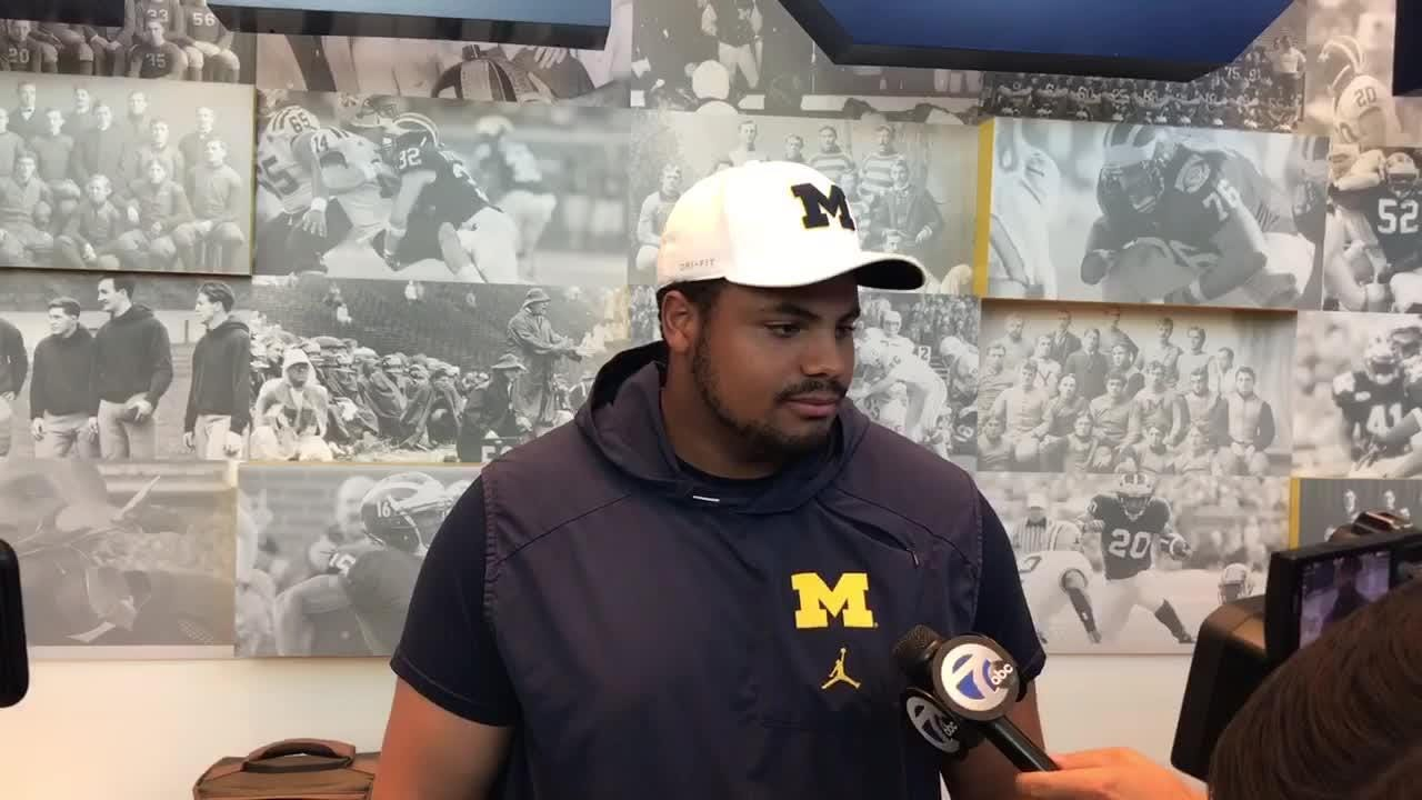 Ex-Michigan OL Grant Newsome speaks with reporters.
