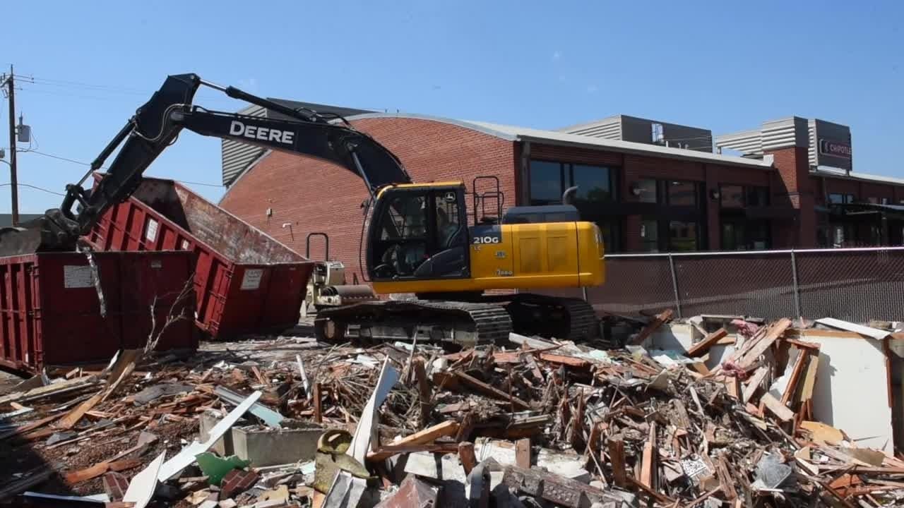 Building demolished for coffee shop drive-thru.