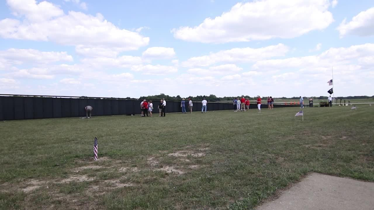 The Wall That Heals, a 3/4-scale replica of the Vietnam Memorial Wall, is exhibited at Spencer J. Hardy Airport