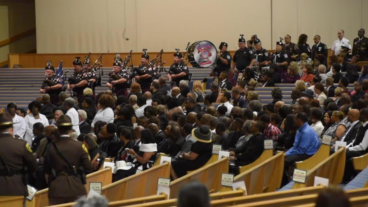 Felled by a hit and run driver while running in Hines Park, Sgt. Smith's life is celebrated at Greater Grace Temple.