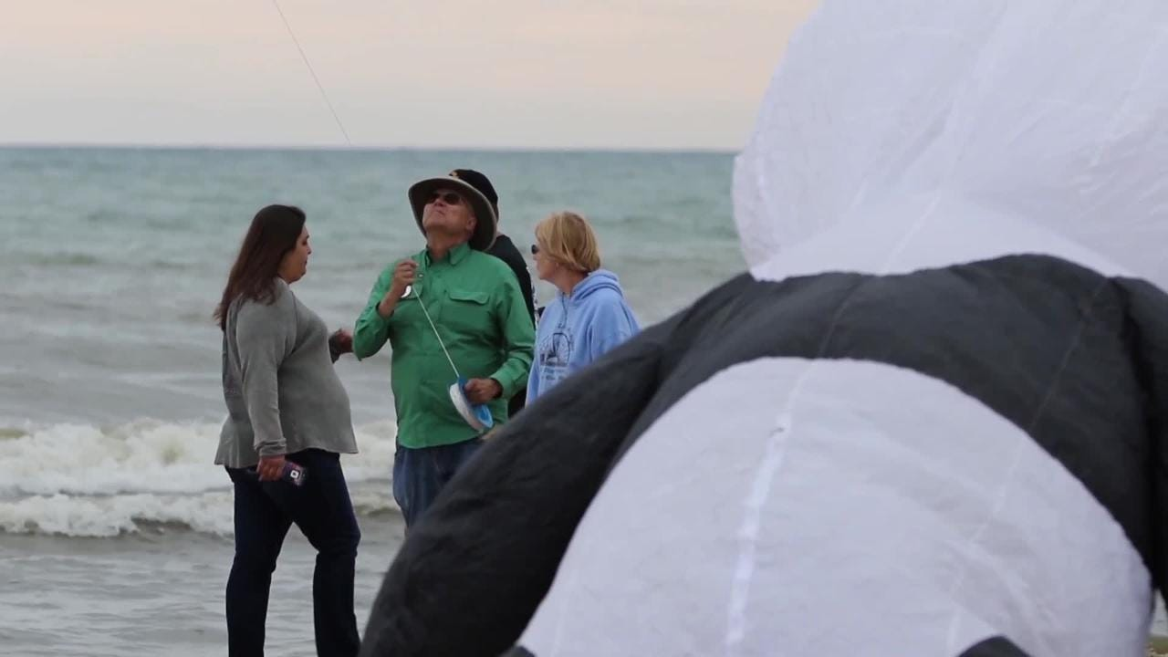 Two Rivers' Unique Flying Objects owner Chow Chong talks Kites Over Lake Michigan.