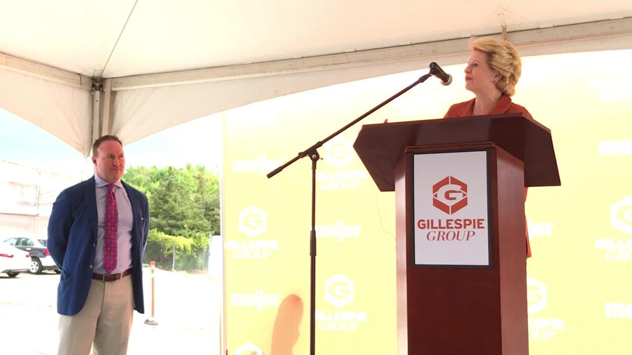 Pat Gillespie, Sen. Debbie Stabenow and Mayor Andy Schor speak during the announcement of a planned mixed-use downtown Lansing development.
