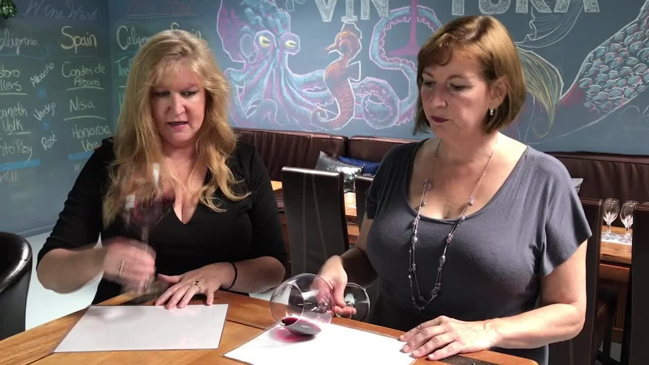 Kristen Shubert of VinTura Tasting Room & Wine Rack in Ventura and Lisa Stoll of Camarillo-based  Explore Wines show the wine-tasting form that earned them a trip to the World Wine Tasting Competition in France next month.