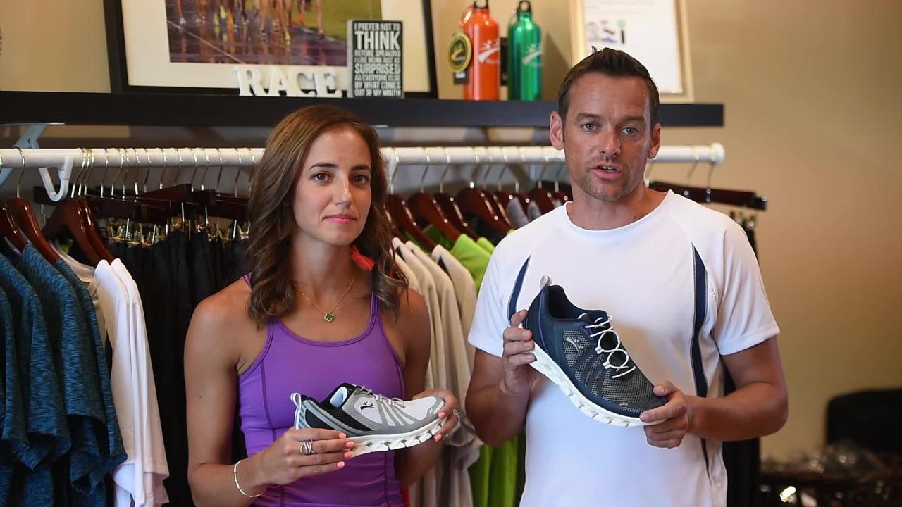 Aidan Walsh and his wife Lindsay Finkel, owners of Racefaster, answer questions about their new athletic sneakers at their store in Ridgewood on 08/07/18
