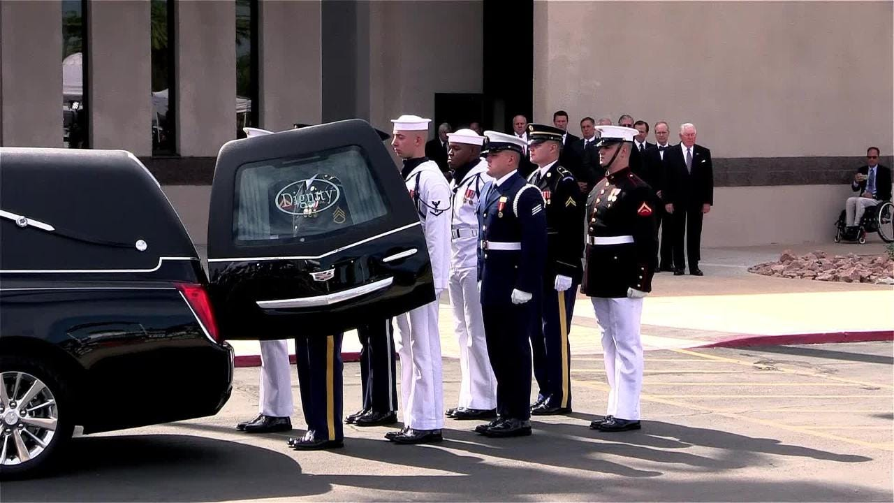 The body  of Sen. John McCain arrives for a memorial service at North Phoenix Baptist Church on Aug. 30, 2018.