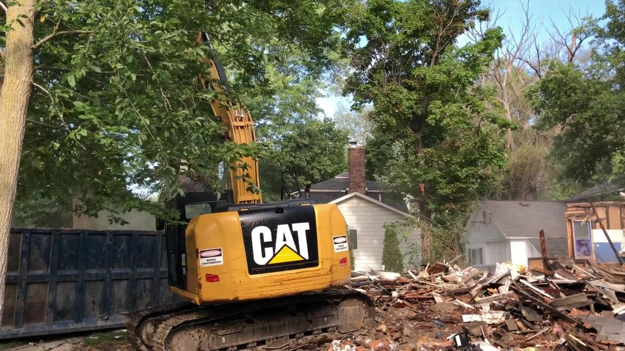 The house at 816 McPherson in Howell was demolished on Friday, more than a year after it was condemned.