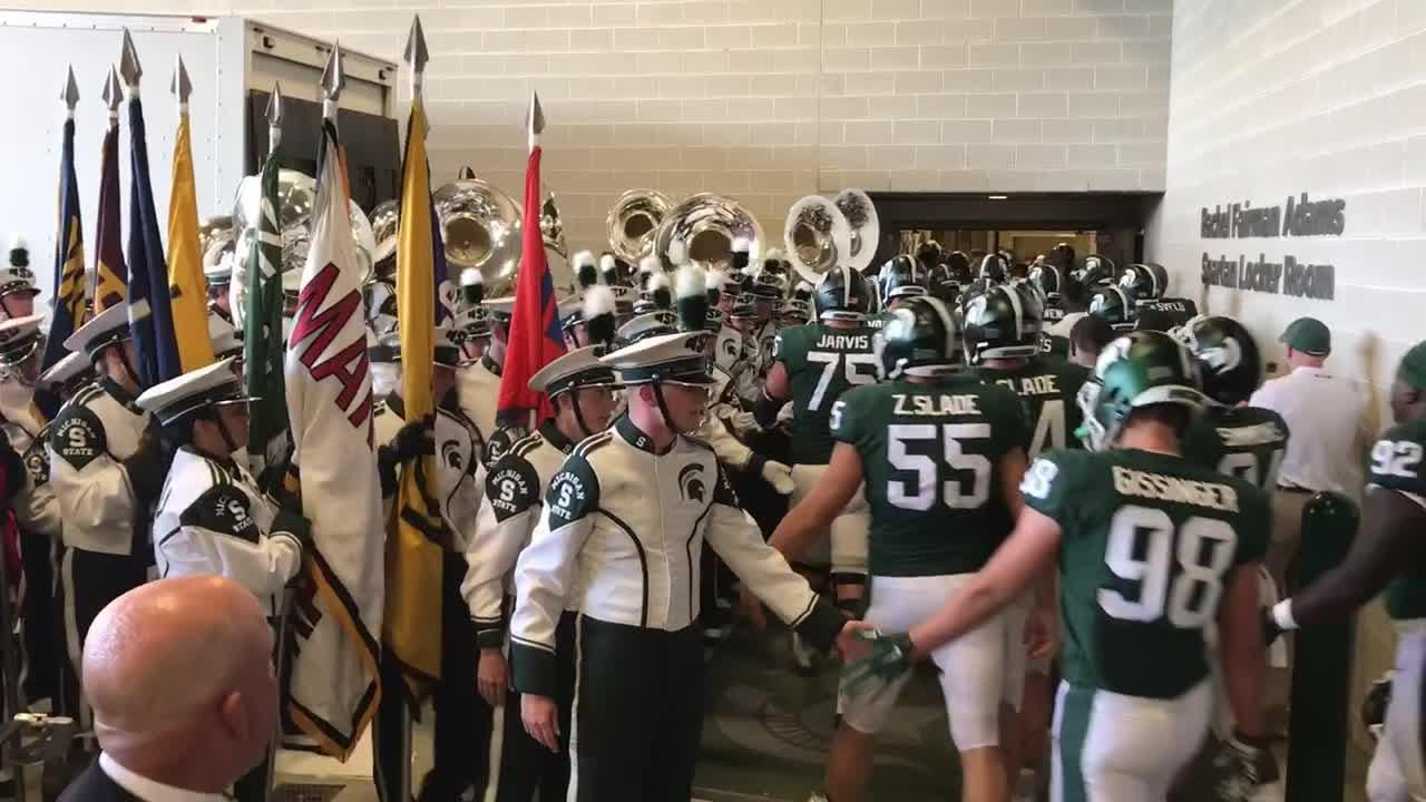The Spartans head to the locker room before the start of their game against Utah State at Spartan Stadium
